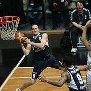 Efes Pilsen's Igor RAKOCEVIC (L) during their Turkish Basketball league derby match Besiktas between Efes Pilsen at the BJK Akatlar Arena in Istanbul Turkey on Saturday 30 April 2011. Photo by TURKPIX