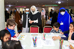 © Licensed to London News Pictures. 07/04/2021. London, UK. Camilla, Duchess of Cornwall, wearing a protective face covering and headscarf, meets the children during a visit to the London Islamic Cultural Society and Mosque (also known as Wightman Road Mosque) in Haringey, north London. The Mosque was formed by a small group of Guyanese Muslims and now supports over 30 different nationalities and community in Haringey and surrounding boroughs. Photo credit: Dinendra Haria/LNP