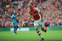Arsenal's Aaron Ramsey celebrates his goal. - Photo mandatory by-line: Dougie Allward/JMP - Mobile: 07966 386802 10/08/2014 - SPORT - FOOTBALL - London - Wembley Stadium - Arsenal v Manchester City - FA Community Shield