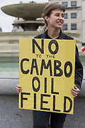 An environmental activist from Extinction Rebellion holds a sign in Trafalgar Square calling for the abandonment of plans for a controversial Cambo oil field during the first day of Impossible Rebellion protests on 23rd August 2021 in London, United Kingdom. Extinction Rebellion are calling on the UK government to cease all new fossil fuel investment with immediate effect.