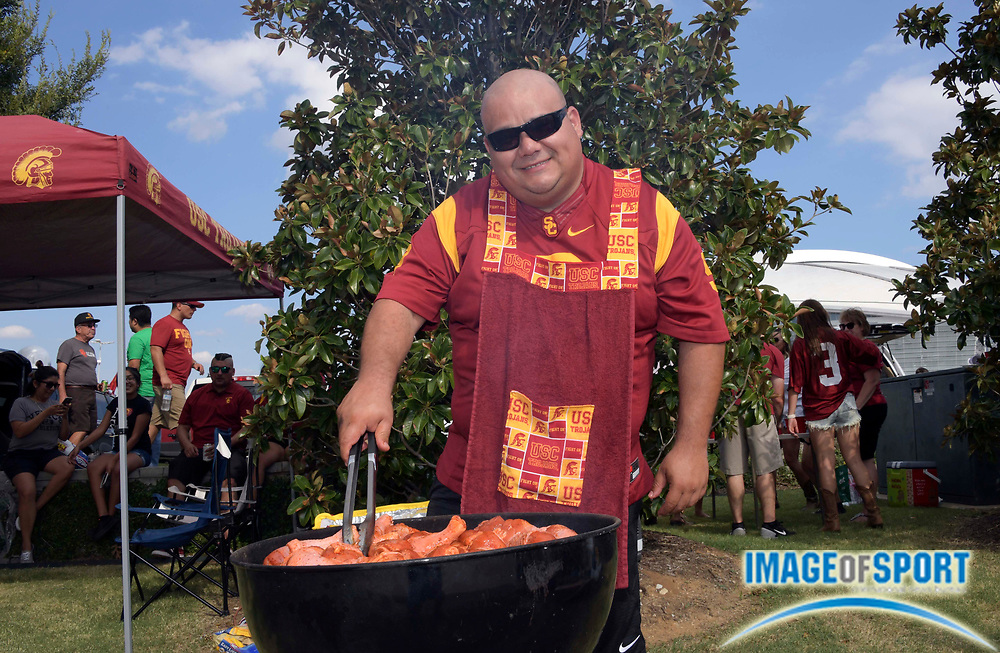 Sep 3, 2016; Arlington, TX, USA; USC Trojans fan Henry Cid grills before the game against the Alabama Crimson Tide at AT&T Stadium.