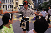 A British soldier with the Scottish British Black Watch Regiment keeps the public safely away from a vehicle leaving the Prince of Wales Barracks, on the eve of the handover of sovereignty from Britain to China, on 30th June 1997, in Hong Kong, China. Midnight signified the end of British rule, and the transfer of legal and financial authority back to China. Hong Kong was once known as fragrant harbour or Heung Keung because of the smell of transported sandal wood.