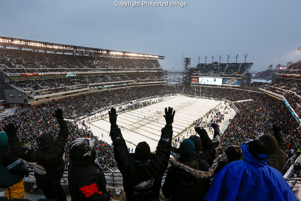 A general view of Lincoln Financial Field with a fan cheering in the foreground during the NFL game between the Detroit Lions and the Philadelphia Eagles on Sunday, December 8th 2013 in Philadelphia. The Eagles won 34-20. (AP Photo/Brian Garfinkel)