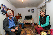 """Alihan Gregorian, 66, (L in picture) father of six children: one son and five daughters. He lost his only son, who was 41 years of age, his name is Alosha Gregorian, who for Fifteen years served in the army. <br /> """"He left for 35 days, he never returned"""" his wife Gulnara Harutian remembers when I visited her house after she invited us upon my visit at the local school in Çartar, which is about 47/km far from Stepanakert (Xankendi) in eastern Nagorno Karabakh.<br /> Alosha was reportedly killed in his position by an Azerbaijani shell the family say. """"He was a sniper shooter"""" his father remembers. Alosha was the father of three children. Two daughters and one son. From the age of 8 from his daughter to 12 years of his son and 15 years of age of his older daughter.<br /> <br /> Gulnara (R in picture), now a widow at her late 30's (38 of age) finds it difficult to raise three children alone, with a recently half-built house by the borderline with Azerbaijani armed forces. Although her house is located within the internationally and newly recognised territory of Azerbaijan, she said she is determined to stay there adding that she's got nowhere to go, however having to pay the price of living in fear that quote: """"Azeris diversants might come in the midst of the night and slit our throats while asleep"""".<br /> Gulnara's father died, while her mother is still alive. She was married to Alosha for sixteen years. <br /> She said she's lucky that parents and family of Alosha are still supporting her. However, her emotional and mental wellbeing appears to be devastating, she also feels that she can't help her children who cannot accept that their father is no longer amongst them. She explained that is very difficult to explain this situation to her children because their father is a figure of protection and they feel unprotected now.<br /> During 44 days of the war, the region saw an end of the conflict after a ceasefire agreement was signed by the leaders of Armenia, Russia and"""
