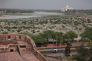 A rickshaw is driving next to the area of the controversial 'Taj Heritage Corridor', sitting between the Agra Fort and the Taj, and next to the heavily polluted and dry Yamuna River, in Agra.