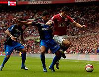 Photo: Jed Wee.<br />Manchester United v Seville. Pre Season Friendly. 12/08/2006.<br /><br />Manchester United's Cristiano Ronaldo (R) attacks.