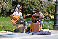 Musicians, buskers, promenade, San Pedro de Alcantara, near Marbella, Spain, 15th April 2018, 201804154332.<br /> <br /> Copyright Image from Victor Patterson, 54 Dorchester Park, Belfast, UK, BT9 6RJ<br /> <br /> t1: +44 28 9066 1296 (from Rep of Ireland 048 9066 1296)<br /> t2: +44 28 9002 2446 (from Rep of Ireland 048 9002 2446)<br /> m: +44 7802 353836<br /> <br /> e1: victorpatterson@me.com<br /> e2: victorpatterson@gmail.com<br /> <br /> The use of any of my copyright images is subject to my Terms & Conditions. It is IMPORTANT that you familiarise yourself with them. They are available at my website, victorpatterson.com.<br /> <br /> None of my copyright images may be used on the Internet unless they are visibly watermarked, i.e. © Victor Patterson within the body of the image. My metadata, denoting my copyright must NOT be deleted. <br /> <br /> Web use is extra at currently recommended NUJ rates. Maximum permitted web size is<br />  400kb. <br /> <br /> Images must not be passed on to a third party - they are for the use of the authorised recipient only.