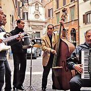 Street musicians playing near the Campo di Fiori in Rome, Italy