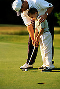 NJ, Morris County, Northeast, Father teaching son to golf
