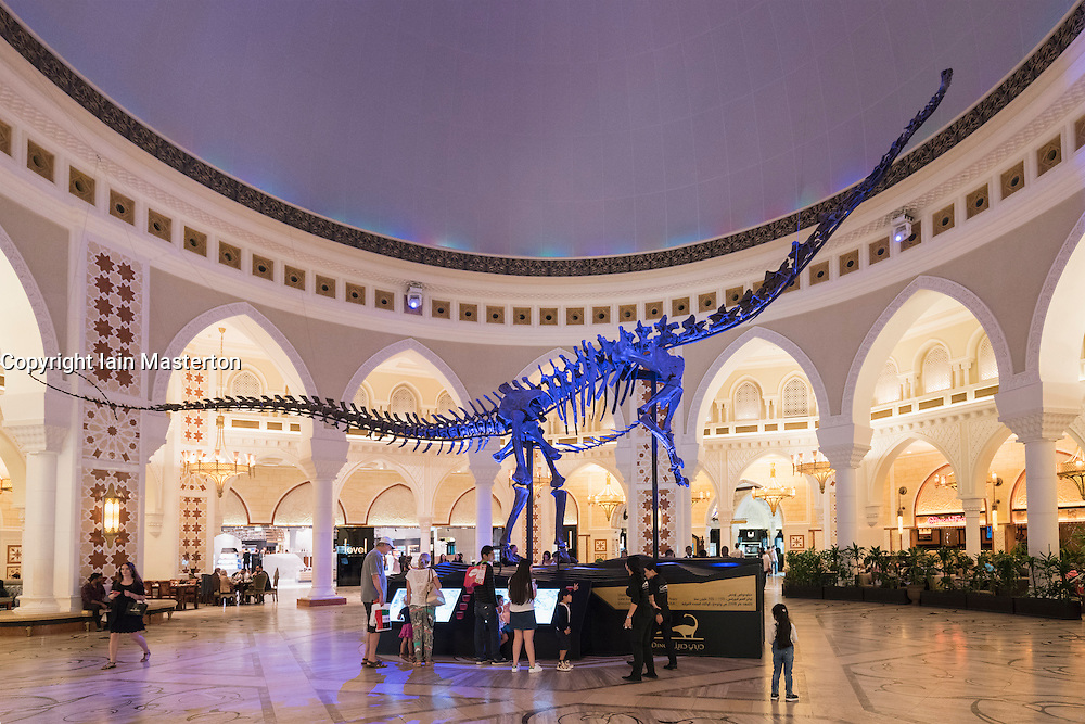 Dinosaur skeleton on display inside Middle Eastern styled The Souk shopping district inside the Dubai mall in Dubai United Arab Emirates