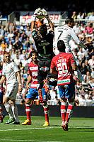 Real Madrid´s Cristiano Ronaldo and Granada´s goalkeeper Oier Olazabal during 2014-15 La Liga match between Real Madrid and Granada at Santiago Bernabeu stadium in Madrid, Spain. April 05, 2015. (ALTERPHOTOS/Luis Fernandez)