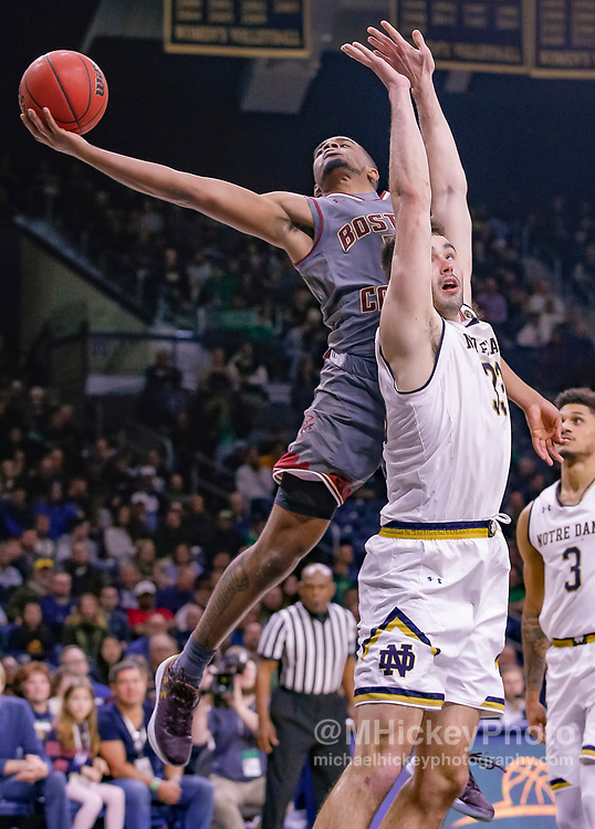 SOUTH BEND, IN - JANUARY 12: Wynston Tabbs #5 of the Boston College Eagles shoots the ball against John Mooney #33 of the Notre Dame Fighting Irish at Purcell Pavilion on January 12, 2019 in South Bend, Indiana. (Photo by Michael Hickey/Getty Images) *** Local Caption *** Wynston Tabbs; John Mooney
