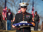 22 NOVEMBER 2019 - DES MOINES, IOWA: US Marine Corps First Sgt. MICHAEL SODERGREN holds a folded United States flag during the reinterment service of US Marine Corps Reserve Private Channing Whitaker in Glendale Cemetery. The flag was presented to Whitaker's family. Whitaker died in the Battle of Tarawa on Nov. 22, 1943. He was buried on Betio Island, in the Gilbert Islands, and his remains were recovered in March 2019. He was identified by a DNA match with surviving family members in Iowa. Whitaker was reintered in the Glendale Cemetery in Des Moines exactly 76 years after his death in World War Two. About 1,000 US Marines and sailers were killed in four days during the Battle of Tarawa.            PHOTO BY JACK KURTZ