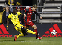 November 21, 2017 - Columbus, OH, USA - Columbus Crew defender Jonathan Mensah (4) knocks the ball away from Toronto FC midfielder Nicolas Hasler (26) in the first half of the first leg of the MLS Eastern Conference finals at MAPFRE Stadium in Columbus, Ohio, on Tuesday, Nov. 21, 2017. (Credit Image: © Kyle Robertson/TNS via ZUMA Wire)