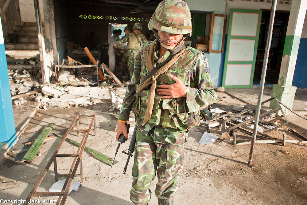 """Sept. 29, 2009 -- YARANG, THAILAND: A Thai soldier turns away after seeing the results of a mysterious explosion in an elementary school office in rural Pattani province, Sept. 29. Muslim militants frequently target schools because they claim the public schools are a symbol of the Bangkok government. No one was hurt in the explosion and the official cause of the blast was undetermined.  Thailand's three southern most provinces; Yala, Pattani and Narathiwat are often called """"restive"""" and a decades long Muslim insurgency has gained traction recently. Nearly 4,000 people have been killed since 2004. The three southern provinces are under emergency control and there are more than 60,000 Thai military, police and paramilitary militia forces trying to keep the peace battling insurgents who favor car bombs and assassination.   Photo by Jack Kurtz / ZUMA Press"""