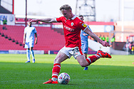 Ben Williams of Barnsley (28) passes the ball during the EFL Sky Bet League 1 match between Barnsley and Coventry City at Oakwell, Barnsley, England on 30 March 2019.