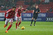 Charlton Athletic forward Nicky Ajose (25) runs into position as Charlton Athletic midfielder Chris Solly (20) takes a shot during the EFL Sky Bet League 1 match between Charlton Athletic and AFC Wimbledon at The Valley, London, England on 15 December 2018.