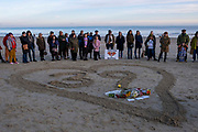 Local residents of the Kent seaside town of Folkestone gather around a heart with the figure 39 in it on Sunny Sands Beach on 27th October 2019 in Folkestone, Kent, UK. The vigil was organised by locals to remember the 39 people discovered in Essex from Vietnam who perished in the back of a truck while being trafficked into the UK inside a refrigerated container.