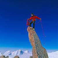 ANTARCTICA. Alex Lowe (MR) atop a pinnacle on 2850-meter Mount Bearskin in the Ellsworth Mountains.