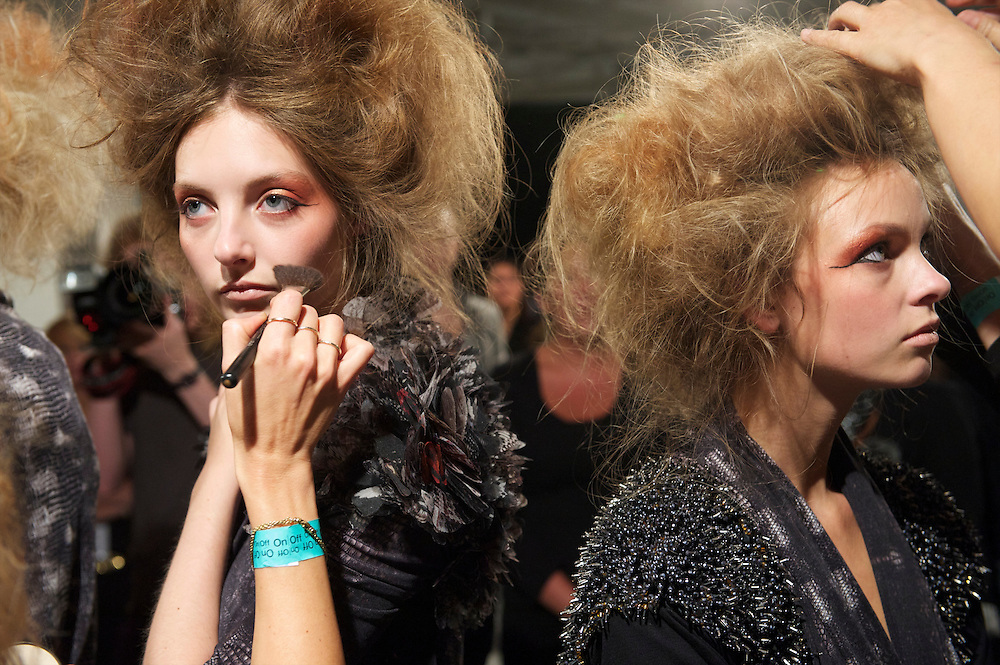 A model is styled backstage before the Aminaka Wilmont spring 2011 fashion show at the On/Off venue in Bloomsbury Square, London on 17 September 2010.