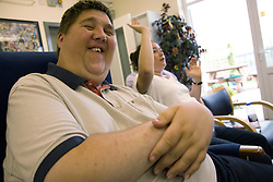 Day service users with learning disabilities taking part in a singing session,