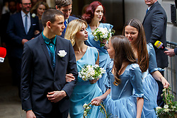 © Licensed to London News Pictures. 05/03/2016. London, UK. Bridesmaids leaving Rupert Murdoch and Jerry Hall's wedding ceremony at St Bride's Church in Fleet Street, London on Saturday, 5 March 2016. Photo credit: Tolga Akmen/LNP