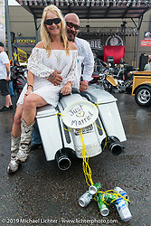 Newleyweds at a very wet Easyriders Magazine Bike Show at the Easyriders Saloon during the annual Sturgis Black Hills Motorcycle Rally. SD, USA. August 5, 2014.  Photography ©2014 Michael Lichter.