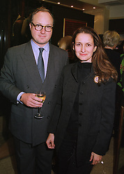 MR MARK LLOYD and MISS ISOBEL GOLDSMITH daughter of the late Sir James Goldsmith, at a party in London on 18th November 1997.MDK 18
