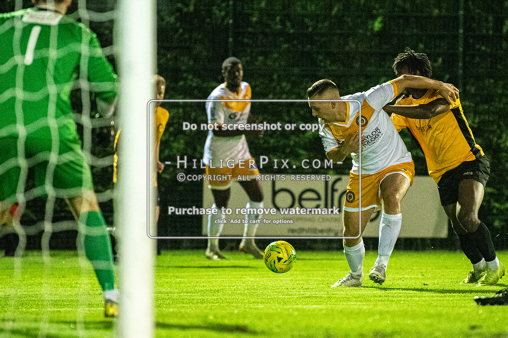 MERSTHAM, UK - OCTOBER 15: Joseph Taylor, of Cray Wanderers FC, gets goal side of his defender during the BetVictor Isthmian Premier League match between Merstham and Cray Wanderers at The Whisky Bible Stadium on October 15, 2019 in Merstham, UK. <br /> (Photo: Jon Hilliger)