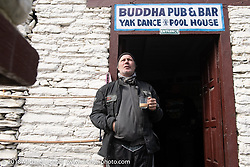 Jonathan Pite on a chai break at the Buddha Pub and Bar in Marpha on day-5  of our Himalayan Heroes adventure riding from Kalopani through the Mustang District to our highest elevation of the trip at over 12,000' when we reached Muktinath, Nepal. Saturday, November 10, 2018. Photography ©2018 Michael Lichter.