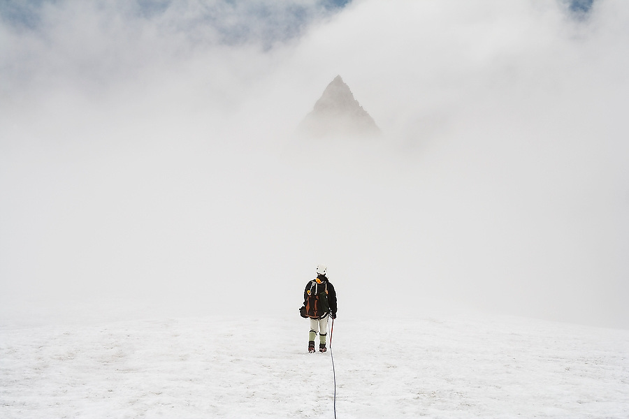 Kevin Steffa leads a climbing team across the Sulphide Glacier below the summit pyramid of Mount Shuksan, North Cascades National Park, Washington.