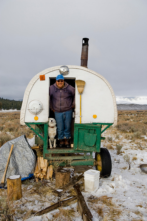 Sheepherder and his dog and sheepwagon in the Sawtooth Valley find themselves in an early winter snow before they have a chance to herd their sheep over Galena Summit and down to lower elevations. Licensing and Open Edition Prints.