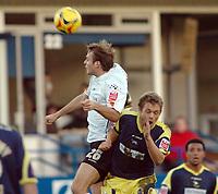 Photo: Kevin Poolman.<br />Luton Town v Derby County. Coca Cola Championship. 18/11/2006. Markus Heikkinen of Luton beats Derby's Morten Bisgaard to the ball.