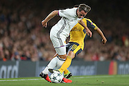 Santi Cazorla of Arsenal tackles Luca Zuffi of FC Basel. UEFA Champions league group A match, Arsenal v FC Basel at the Emirates Stadium in London on Wednesday 28th September 2016.<br /> pic by John Patrick Fletcher, Andrew Orchard sports photography.