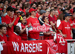 Arsenal fans show their support for manager Arsene Wenger in the stands during the Premier League match at the Emirates Stadium, London.