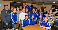 Dave Henrick owner of the 405 Restaurant welcomed Dave Pinkham and the Gilford High School soccer team on Monday evening for a pizza party to celebrate their state championship win.   (Karen Bobotas/for the Laconia Daily Sun)