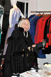 LADY COBURN at a dinner hosted by Carmen Haid at Atelier Mayer, 47 Kendal Street, London W2 on 21st February 2012.