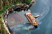 Alaska. Prince William Sound. Oily sheen rinsed from beach by Maxi Barge is captured by boom network.