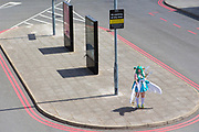 UNITED KINGDOM, London: 25 May 2019 <br /> A cosplay fan waits for friends outside of the London ExCeL during the MCM London Comic Con earlier today. Thousands of cosplay enthusiasts will come to the ExCeL Centre this weekend to enjoy the convention.