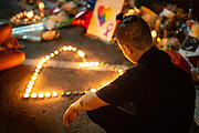 A tribute to the victims of the shooting at Pulse nightclub is seen shaved into the haircut of Christina Rivera, 27, as she mourns the lives lost at the memorial site outside the club in Orlando, Florida, U.S. Rivera, a member of the LGBTQ community herself, had planned to attend Pulse the night of the shooting but decided not to go at the last minute.