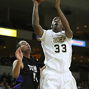Central Florida forward Keith Clanton (33) drives to the basket during an NCAA basketball game against the Furman Paladins at the UCF Holiday Classic at the UCF Arena on December 29, 2010 in Orlando, Florida. (AP Photo/Alex Menendez)