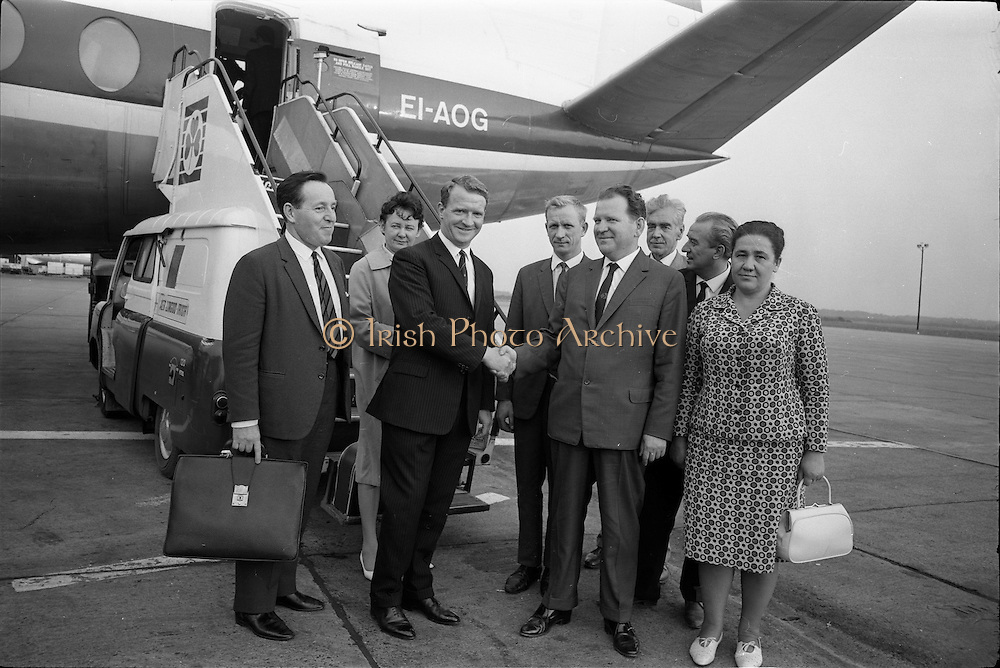 12/07/1967<br /> 07/12/1967<br /> 12 July 1967<br /> Russian trade delegation at Dublin Airport. A trade delegation led by the Deputy Minister for Food, Mr S.I. Brovkin, arrived in Dublin from Glasgow on a private visit to Bollards Biscuit Factory at Deansgrange. Picture shows Mr Denis N. Henderson, (left) Brand Manager, Bollards Biscuits, welcoming Mr S.I. Brovkin, Deputy Minister, Ministry of Food, U.S.S.R.. In centre is Mr V.I. Churiov, Moscow Interpreter. The Soviet party also included Mrs A.E. Glove, Director of Department, Ukrainian Baking Industry; Mrs M.N. Isthmian, Director, All Union Institute Baking Industry and Mr N.V. Karyshensky, Deputy Chief Engineer, Bolshevik Biscuit Co., accompanied by Mr F.H. Arscott, Deputy Managing Director, Baker Perkins (Exports) Ltd. and Mr. Sloan (British Interpreter). The tour had been arranged by Baker Perkins Ltd. of Peterborough who made much of the machinery in Bollards Factory.