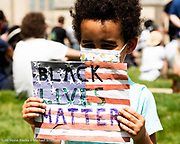 """June 4, 2020 - Washington, DC, United States: Boy with """"Black Lives Matter"""" sign at a protest supporting Black Lives Matter at the National Cathedral."""