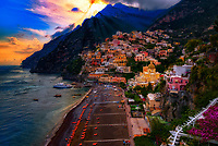 """""""The mystical evening sunlight peeking through the clouds of Positano""""…<br /> <br /> After an exhilarating drive along the high cliffs on the Amalfi coast from Sorrento down to Positano, I found myself in sensory overload with its beauty and photogenic appeal.  After circling around the entire village and its cliffside three times on Positano's only street, which was a single lane winding down from the top and back up and over to where I began, I finally found the parking garage by the hotel, about 2/3rds up the facing village in this image.  The climb down the winding road and steep staircases made for quite a workout in the hot late May sun.  Reaching the beach and marina, I forgot about my exhaustion and could not capture enough of Positano's plush beauty; however, the large amount of tourists and bright sun did not allow for ideal conditions.  Walking the length of the beach, I found a very, very steep staircase leading straight up to a large veranda at the Albergo California.  Taking an exhaustive seat on a plush lounge chair with a perfect view to watch the sunset behind the Amalfi Cliffs, I was taken back by a pleasant Italian (Positano) waiter from the hotel offering a towel, ice water, and drinks for the evening.  I expressed that I was not staying at the hotel, but he didn't seem to mind and proceeded to educate me on the culture of this historic resort village.  The sunset was being coy and didn't appear to cooperate, but during opportune moments it mystified the cloud arrangement and contributed just enough light and color to satisfy a weary photographer."""