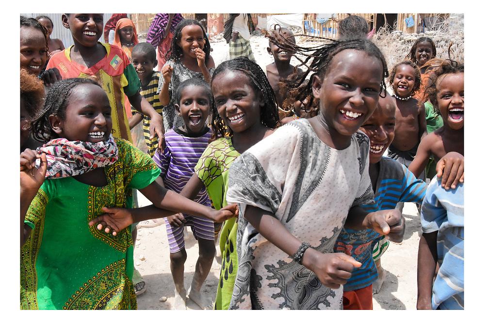 Afar girls and boys laugh after a jumping game. Asaita Refugee Camp, Afar, Ethiopia 2016