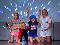 """After singing """"Masterpiece"""" with her backup singers Ava Hosmer, Drea Campo and Amelia Hosmer  the girls take a bow for the crowd at the Holy Trinity talent show Tuesday afternoon.  (Karen Bobotas/for the Laconia Daily Sun)"""