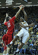 January 26, 2012: Nebraska Cornhuskers center Jorge Brian Diaz (21) blocks a shot by Iowa Hawkeyes forward Melsahn Basabe (1) during the NCAA basketball game between the Nebraska Cornhuskers and the Iowa Hawkeyes at Carver-Hawkeye Arena in Iowa City, Iowa on Thursday, January 26, 2012.