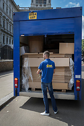 © Licensed to London News Pictures. 12/07/2016. London, UK. A removals van driver is seen with cardboard boxes before driving in the back entrance of Downing Street. Theresa May will become Prime Minister tomorrow after the last candidate for leadership of the Conservative party stood down. Photo credit: Peter Macdiarmid/LNP