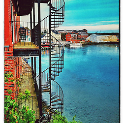 """A spiral staircase next to the Piscataqua River in Portsmouth, New Hampshire. iPhone photo - suitable for print reproduction up to 8"""" x 12""""."""
