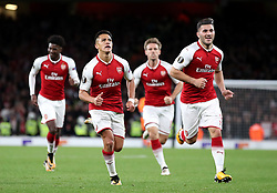 Arsenal's Alexis Sanchez (second left) celebrates scoring his side's first goal of the game during the Europa League match at the Emirates Stadium, London.